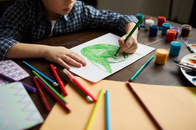 Boy drawing monster