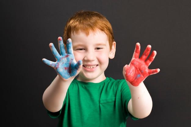 Boy draws  using paints