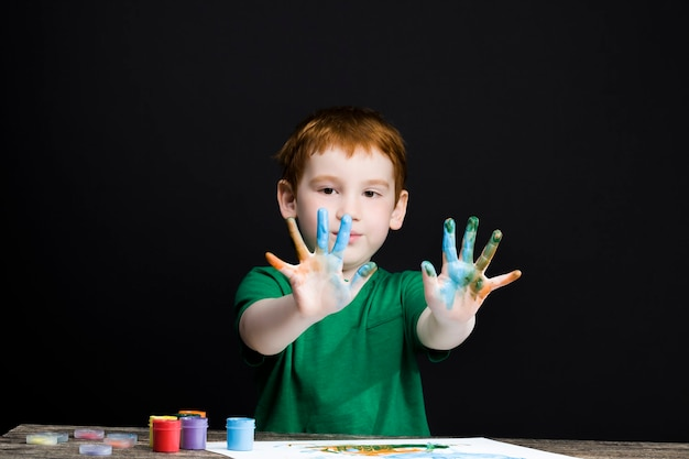 Boy draws with his hands