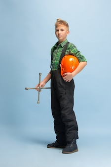 Boy dreaming about future profession of engineer