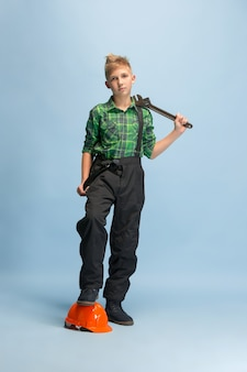 Boy dreaming about profession of engineer