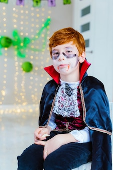 Boy dressed as a spooky vampire for halloween