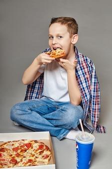 Boy enjoy eating pizza