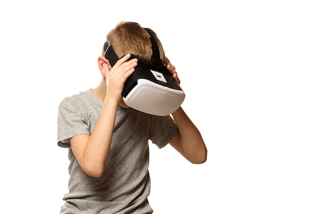 Boy experiencing virtual reality head bowed. isolate on white