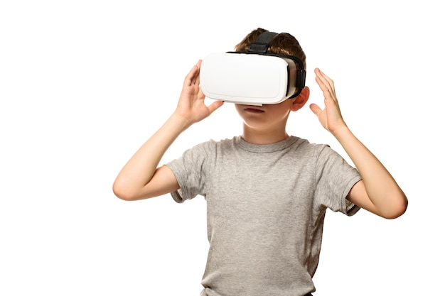 Boy experiencing virtual reality. portrait. isolate on white