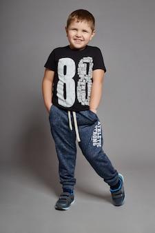 Boy fashionable clothes posing