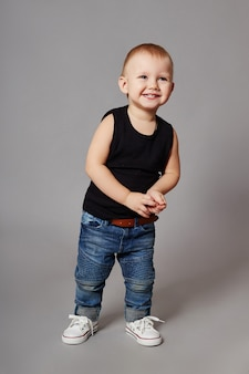 Boy fashionable clothes posing