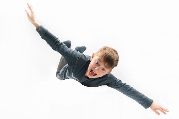 Boy flies like an airplane