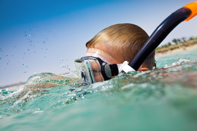 Boy floats in the sea