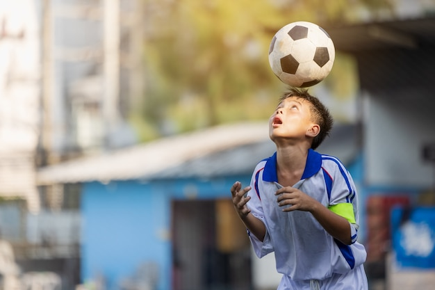 Boy on the football training, skills with the soccer ball local thailand