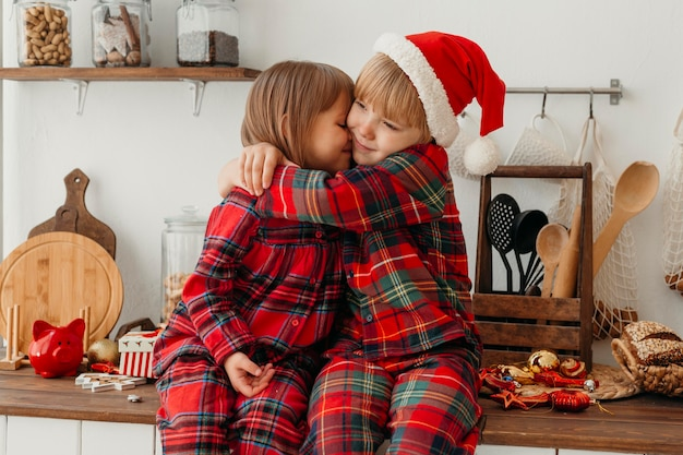 Boy and girl hugging on christmas day