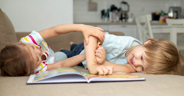 Boy and girl playing while reading