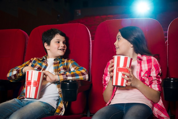 Boy and girl watching movie in cinema