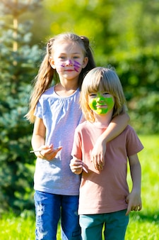 Boy and girl with painted faces.