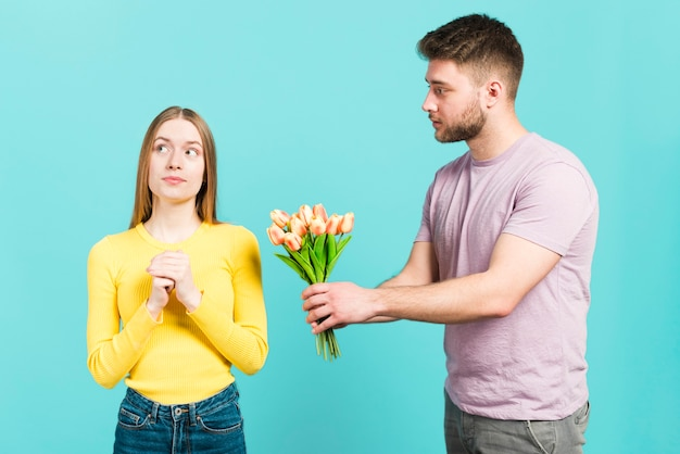 Boy giving flowers to his girlfriend