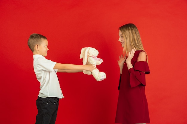 Boy giving soft plushie to a girl