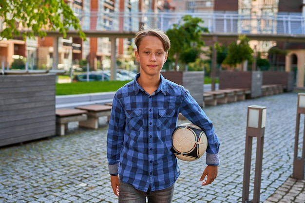 Boy goes to a football lesson.