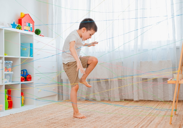 Boy going through a rope web