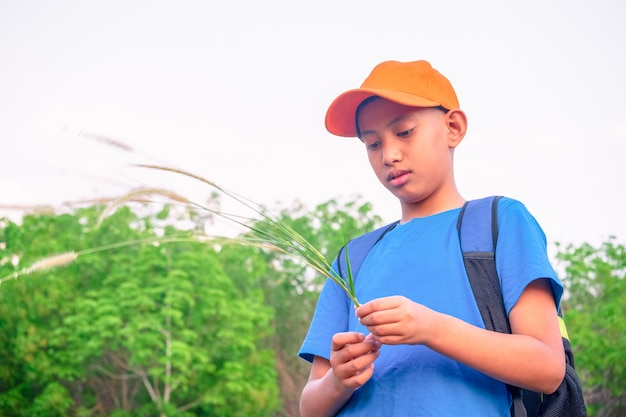 Boy in green forest playing exporing and adventure concept