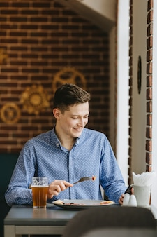 Boy having a beer in a restaurant