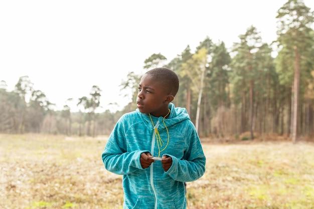 Boy having fun in the woods