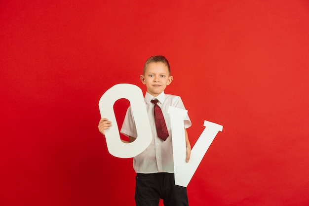 Boy holding letters o and v