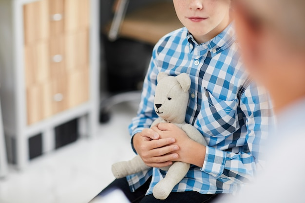 Boy holding toy at doctors office