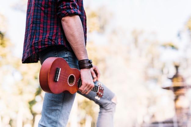 Boy holding an ukelele