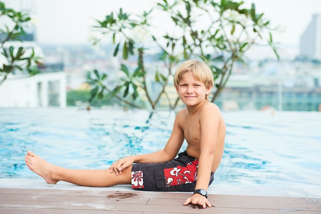 Boy at hotel swimming pool