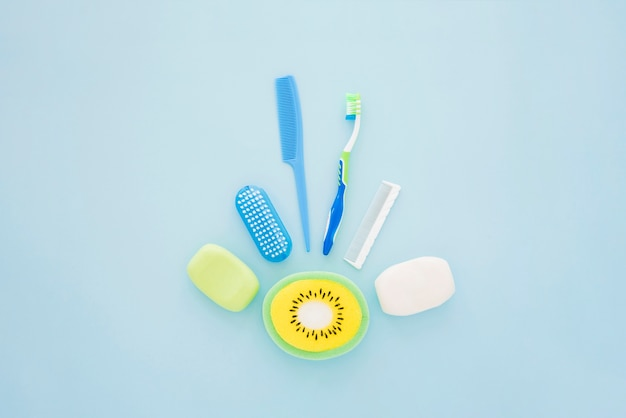 Boy hygienic accessories on blue surface