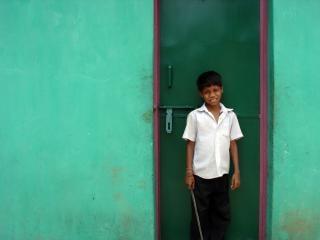 Boy infront of green door