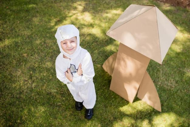 Boy is dressing up as an astronaut