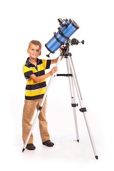 Boy is looking into telescope