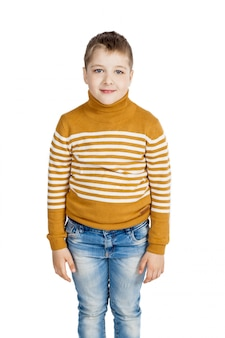 Boy in jeans and striped sweater on a white background