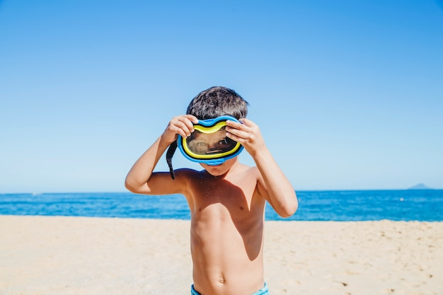 Boy joking with goggles