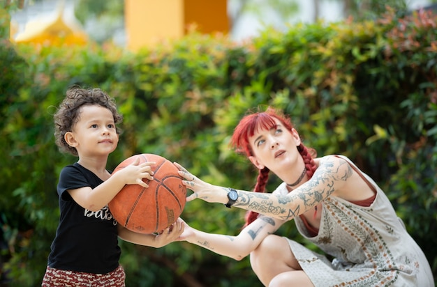 Boy kid and mother playing together, mother's day concept