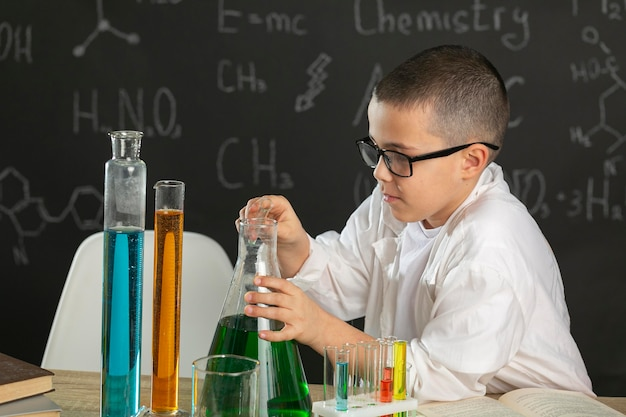 Boy in laboratory doing tests