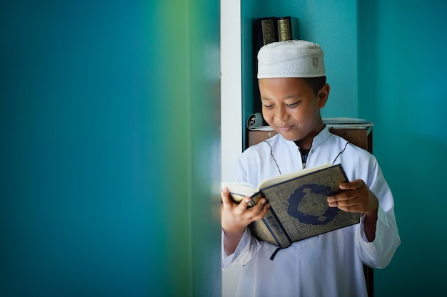 The boy learned to read the quran from inside the mosque, a concept of the next generation of islam.