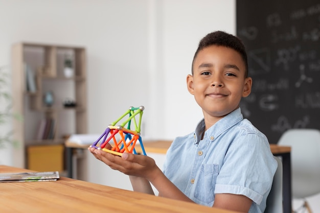 Boy learning more about chemistry in class