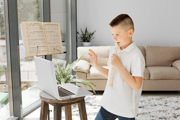 Boy learning online courses from laptop