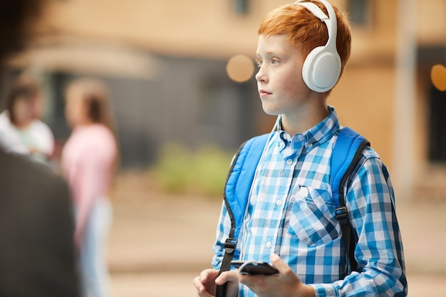 Boy listening to music after school