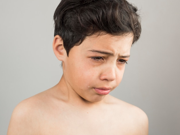 Boy looking down and being upset