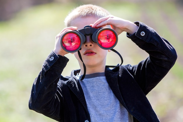 Boy looking through binoculars.