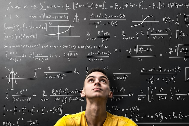 Boy looks apprehensively at a mathematical formula