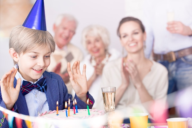 Boy making birthday wish