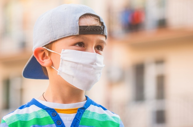 Boy in a medical mask. boy in a surgical bandage.