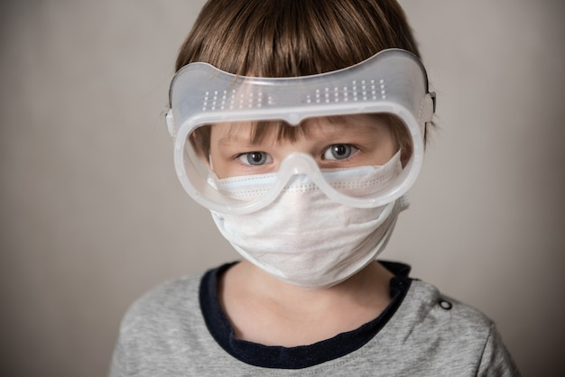 Boy in medical mask. coronavirus covid-19 lockdown, panic. vaccine from new virus. negative emotions