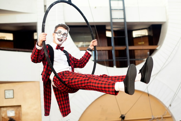 Boy mime in the air on a circle