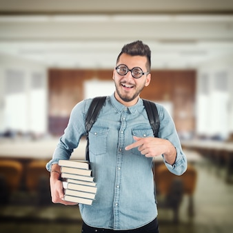 Boy nerd studying books for an exam