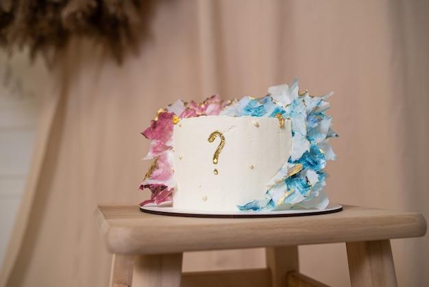 「男の子か女の子」のケーキと性別披露パーティーのさまざまなお菓子